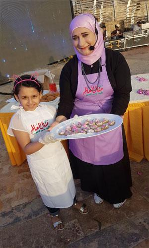 شاهد بالصور أطفال الطائف يحتفلون بمهرجان ورد الطائف 13 مع منال العالم -2